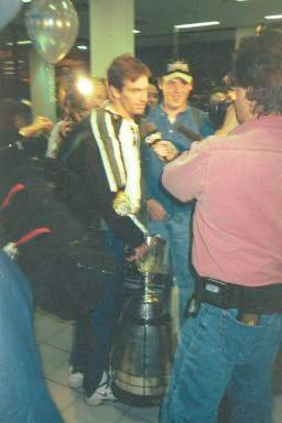 Masotti with Cup in Media scrum